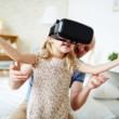 57753032 - cute child enjoying virtual reality